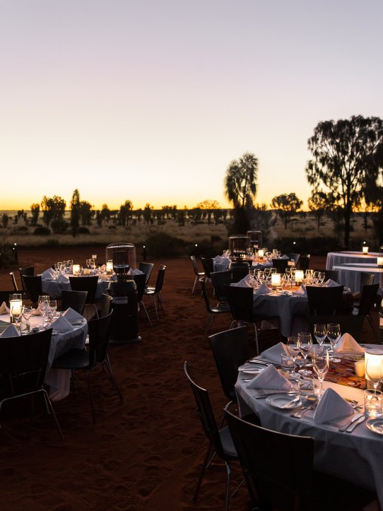Dining tables set up outdoors at dusk
