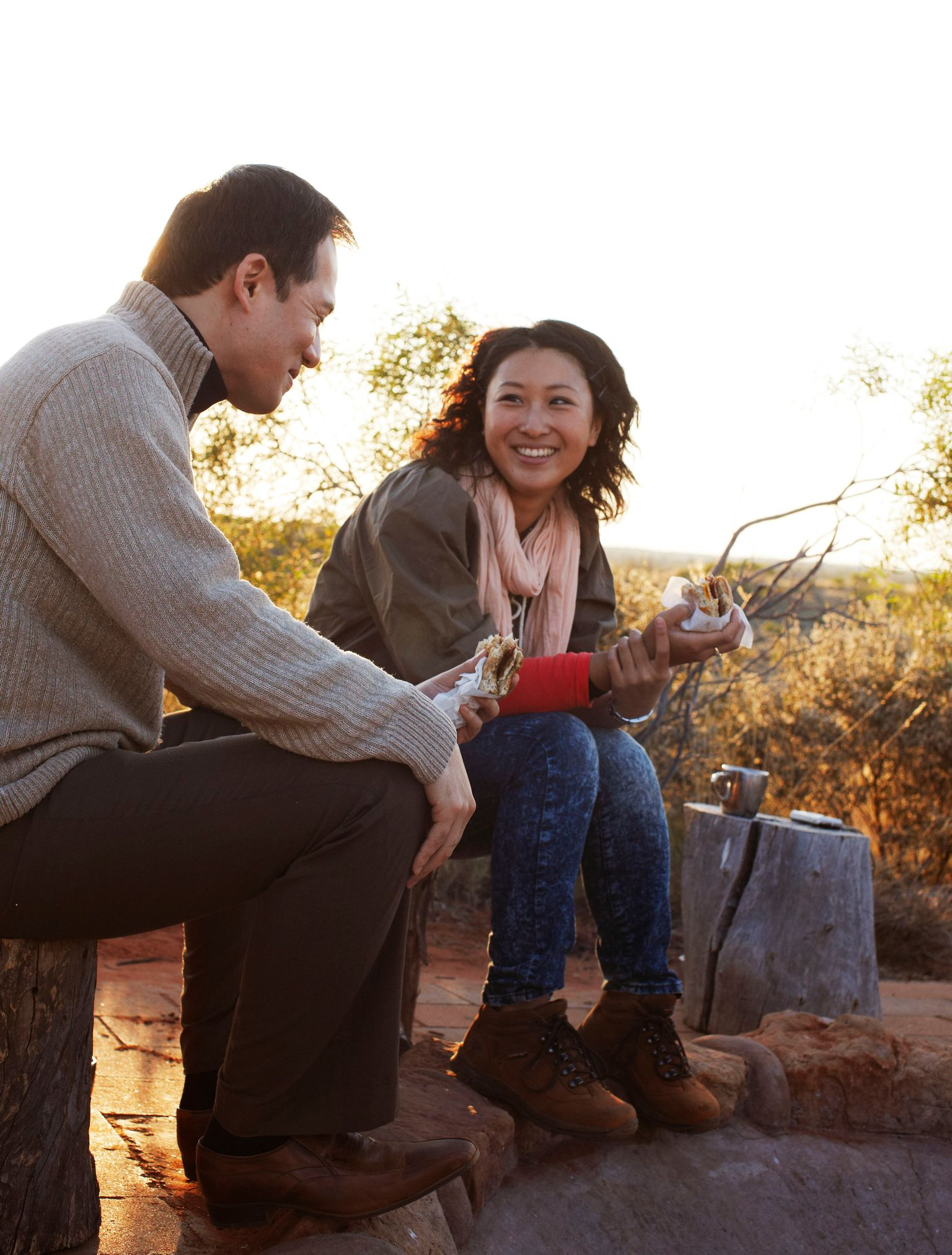 couple around the campfire at Desert Awakenings in Ayers Rock