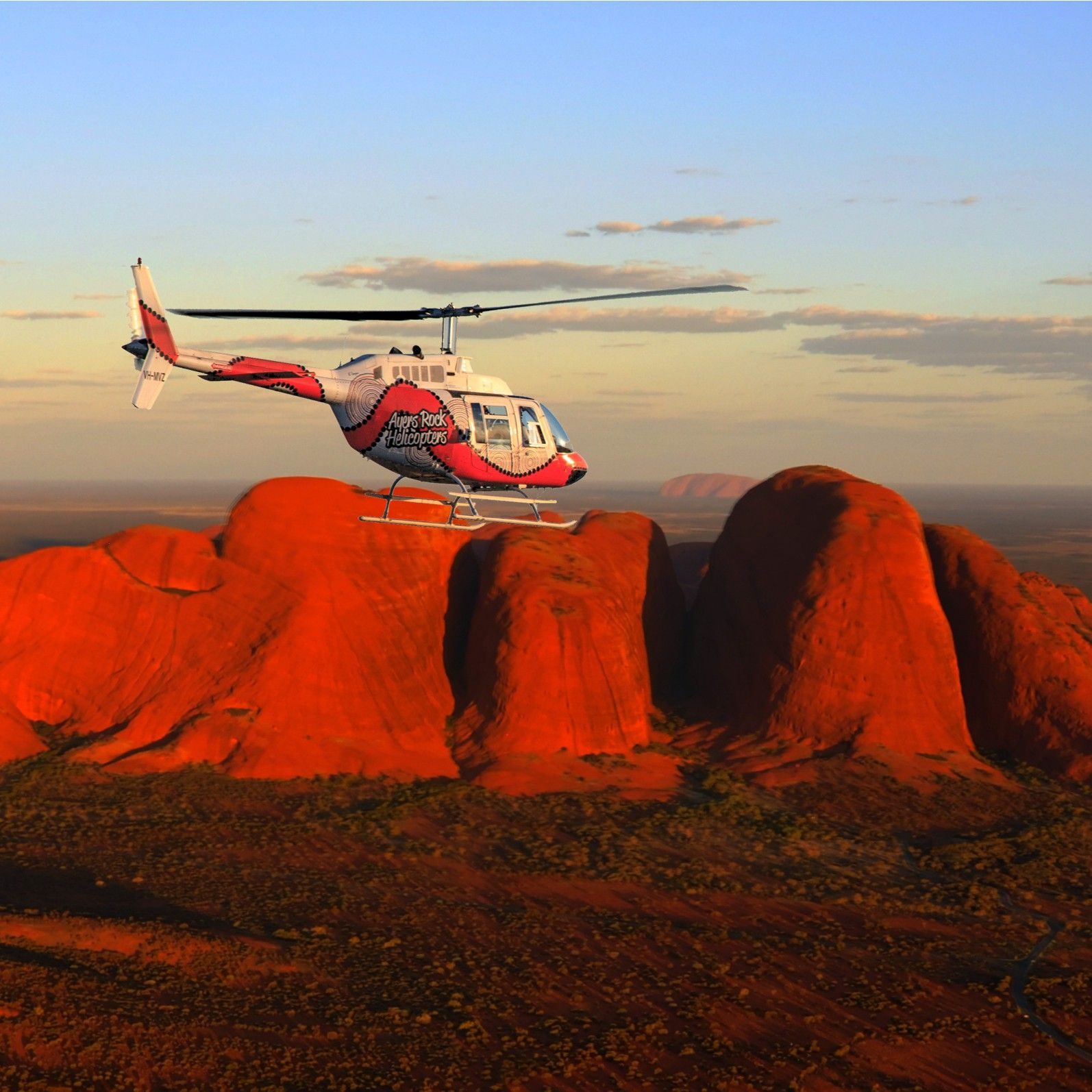 Helicopter above Ayers Rock Resort