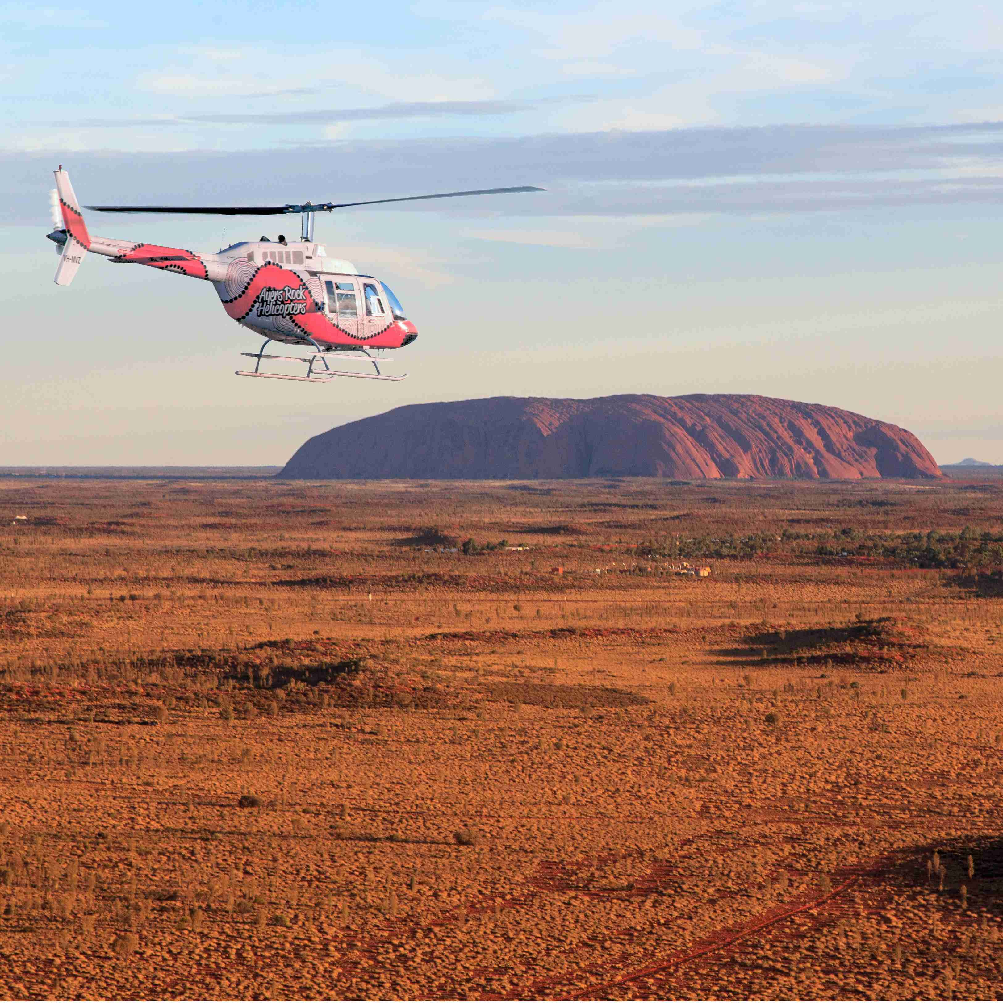 Helicopter above Ayers Rock