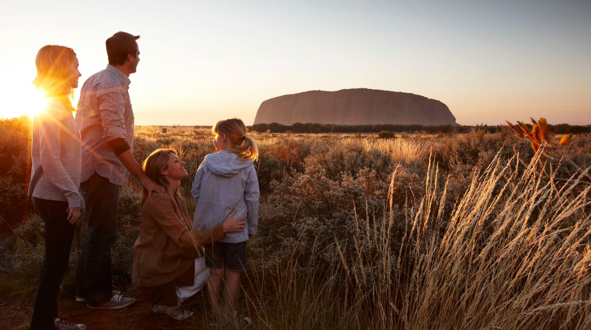 family in front of Ayers Rock