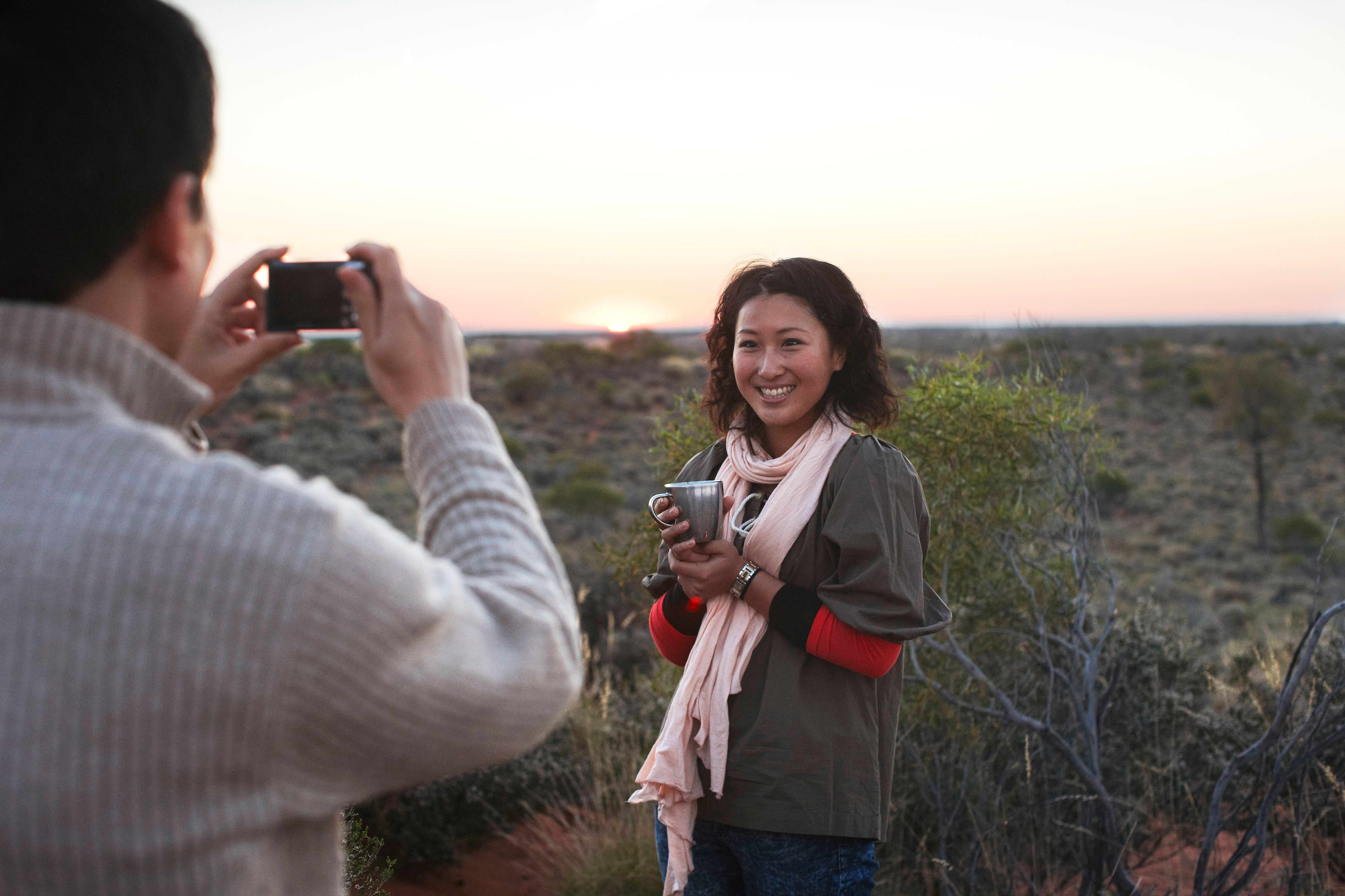Couple taking photo in outback