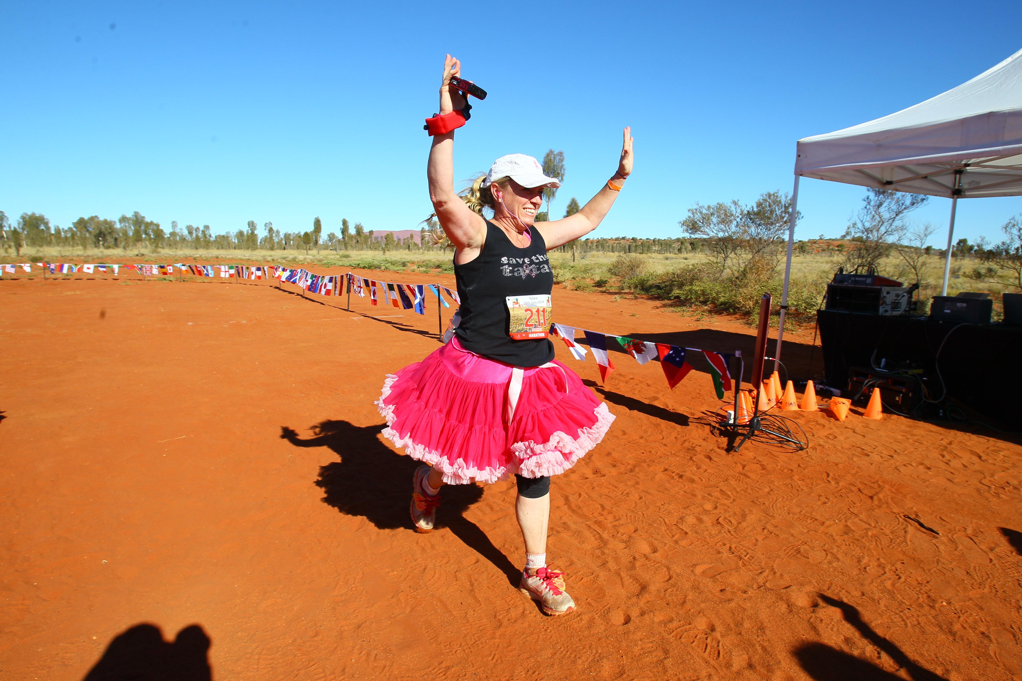 A Woman runs in a tutu in the Australia Outback Marathon