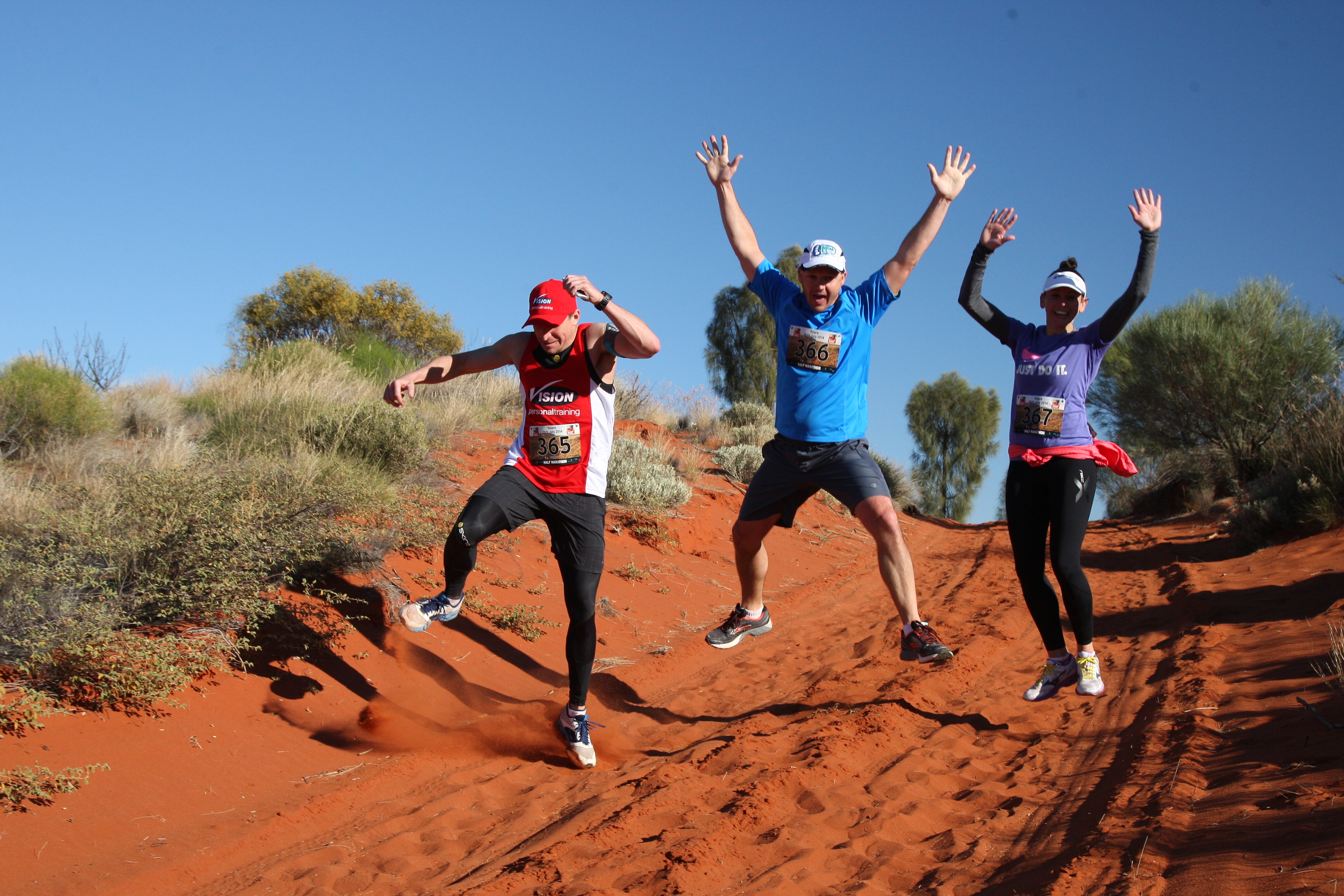 Runners jump excitedly in the Australian Outback Marathon