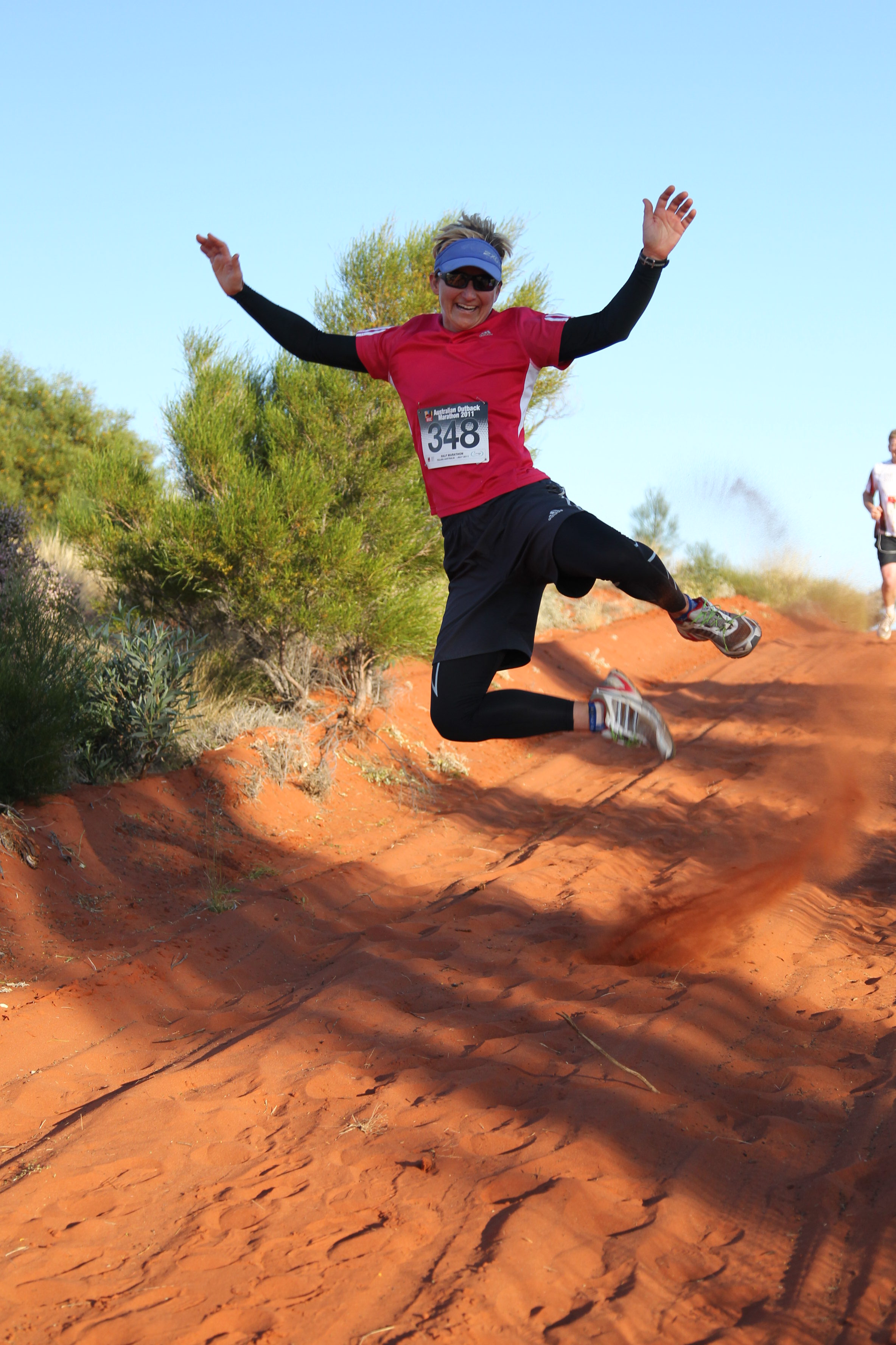 A woman jumps while running the Australia Outback Marathon