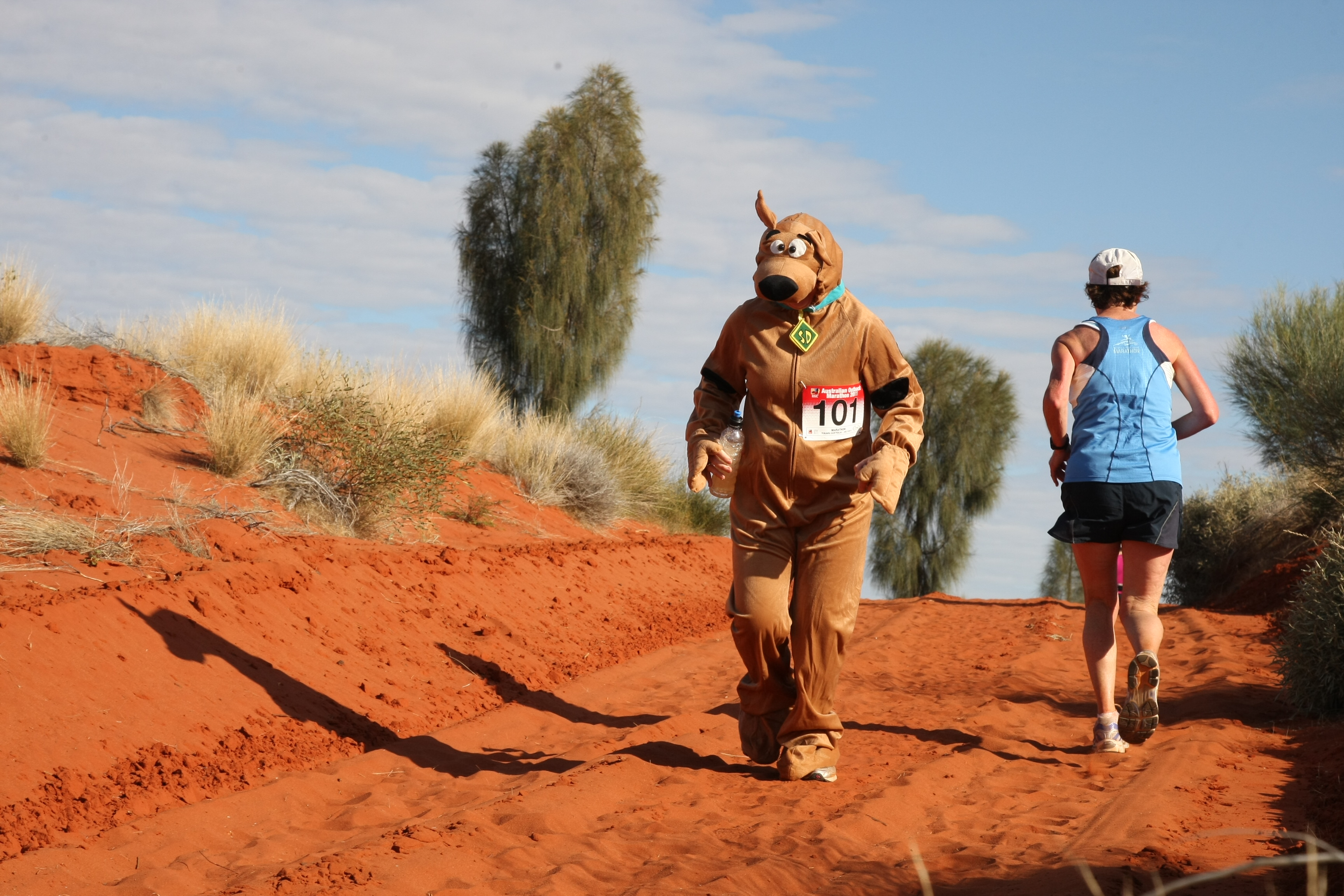 A person runs in the Australia Outback Marathon dressed as Scooby Doo