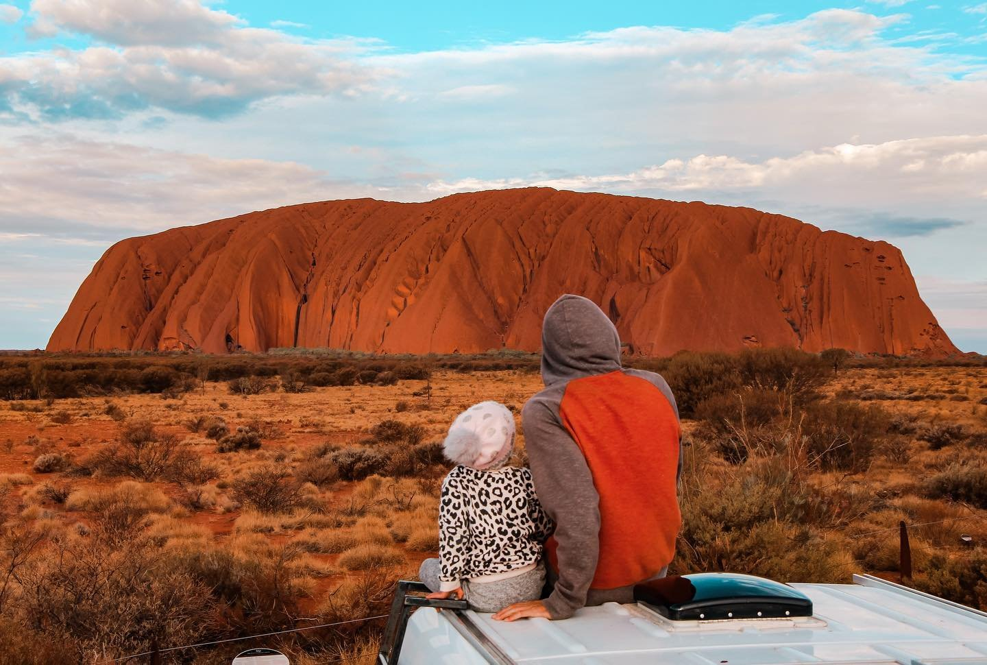 A man and child dressed for chilly weather at Uluru