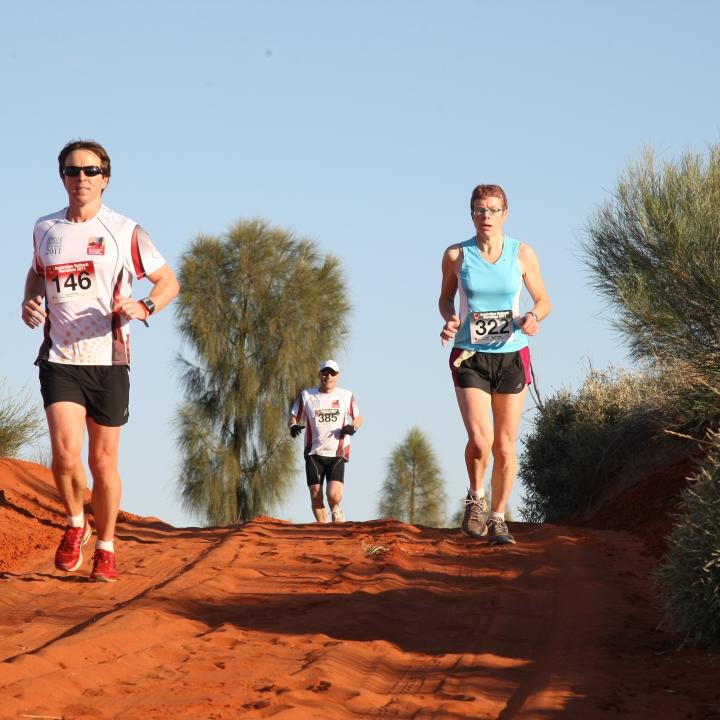 Runners compete in the Australian Outback Marathon