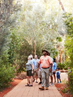Group taking guided tour of gardens at Ayers Rock Resort