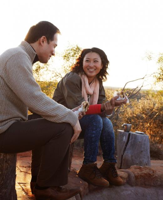 couple around the campfire at Desert Awakenings in Ayers Rock