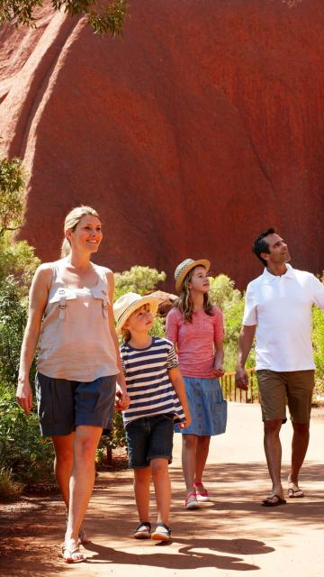 Family with 2 young children on base walk of Ayers Rock Uluru