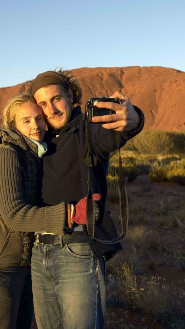 Couple takes a selfie in front of Uluru