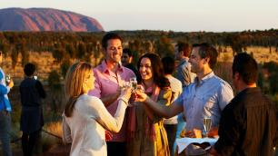 group drinking wine in the outback