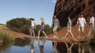 people hiking in the outback