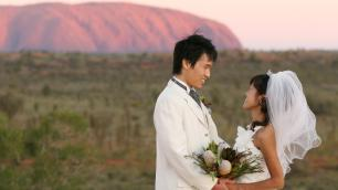 newly married couple by Ayers Rock