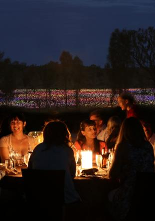 Dinner by candlelight in front of Field of Light at Ayers Rock