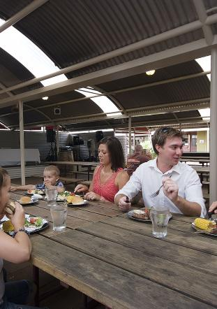 A family enjoys an assortment of food at the Ayers Rock Resort